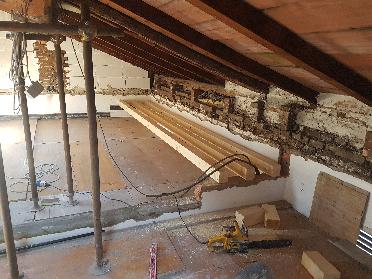 Recupero di sottotetto per ampliamento di abitazione privata a Bologna